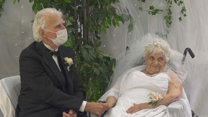 Neil and Delores Videto celebrate their 70th wedding anniversary at Marionhill Long-Term Care Home in Pembroke, Ont. Wed., Oct. 13, 2021. Neil was unable to enter the home during the pandemic but visited Delores at her window every day. (Dylan Dyson / CTV News Ottawa)