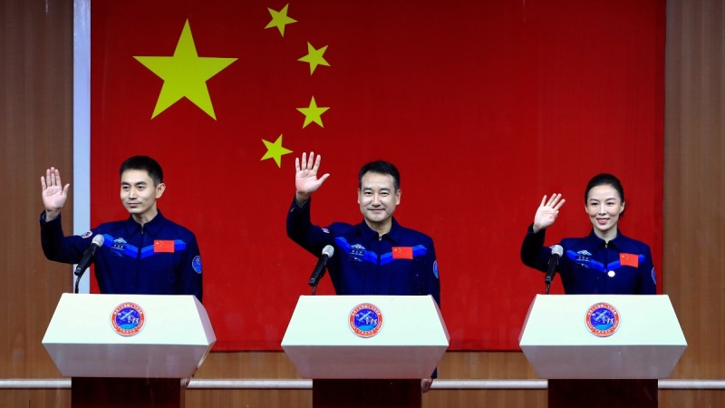 Chinese astronauts, from left, Ye Guangfu, Zhai Zhigang and Wang Yaping arrive for a press conference at the Jiuquan Satellite Launch Centre ahead of the Shenzhou-13 launch mission from Jiuquan in northwestern China, on Oct. 14, 2021. (Ju Zhenhua / Xinhua via AP)