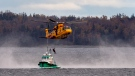 A Royal Canadian Air Force CH-149 Cormorant helicopter performs search and rescue training with M/V Halmar, a multi-purpose vessel owned by Dominion Diving, in Halifax harbour on Tuesday, Oct. 27, 2020. THE CANADIAN PRESS /Andrew Vaughan