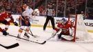 Samuel Montembeault (33) saves a goal against New York Islanders during the first period of an NHL hockey game from the Florida Panthers on April 4, 2019. (AP Photo/Brynn Anderson)