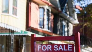 A for sale sign is displayed in front of a house in the Riverdale area of Toronto on Wednesday, September 29, 2021. (THE CANADIAN PRESS / Evan Buhler)