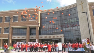 Students All Saints Catholic High School in Ottawa release 48 biodegradable balloons into the air for George Floyd's 48th birthday. (Dave Charbonneau/CTV News Ottawa)