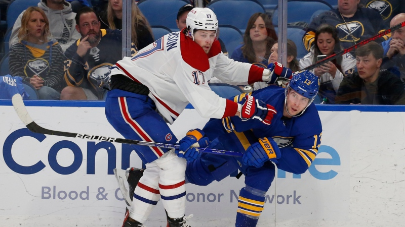 Buffalo Sabres defenseman Mark Pysyk (13) and Montreal Canadiens forward Josh Anderson (17) collide during the second period of an NHL hockey game Thursday, Oct. 14, 2021, in Buffalo, N.Y. (AP Photo/Jeffrey T. Barnes)