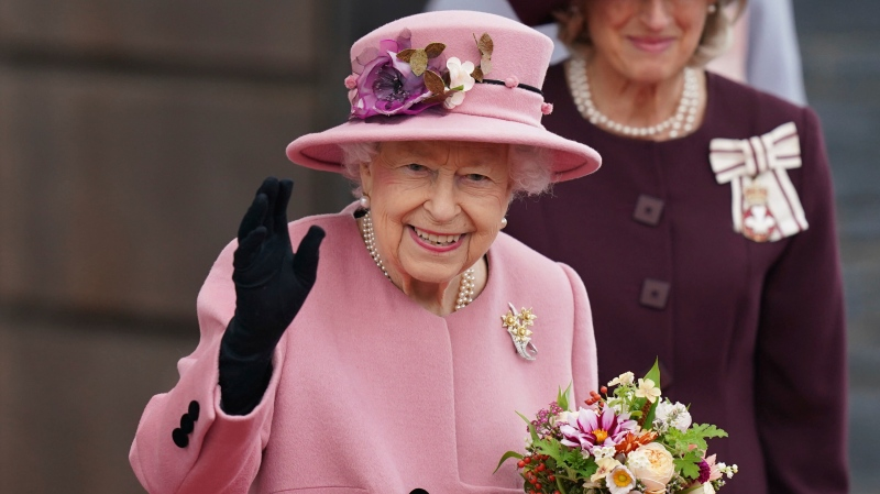 Queen Elizabeth II leaves after the opening ceremony of the sixth session of the Senedd in Cardiff, Wales, Thursday Oct. 14, 2021. (Jacob King/PA via AP)