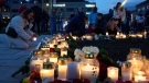 Flowers and candles are placed at the scene of an attack on the square, in Kongsberg, Norway, Thursday, Oct. 14, 2021. (Terje Bendiksby/NTB via AP)