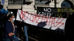 People hold a banner reading No Green Pass during a protest in Rome, on Oct. 15, 2021. (Cecilia Fabiano / LaPresse via AP)