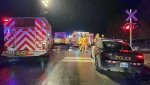 Emergency crews on scene of a crash between a car and a train in New Tecumseth on Thursday, October 14, 2021 (Tristan Phillips/CP24)
