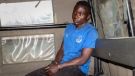 Masten Wanjala in the back of a police truck after being taken by police to a scene to identify the location of alleged victim remains, on the outskirts of Nairobi, Kenya on July 14, 2021. (AP)