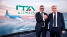 Fabio Lazzerini, left, CEO of new national carrier ITA, poses with President Alfredo Altavilla during the presentation in Rome, on Oct. 15, 2021. (Roberto Monaldo / LaPresse via AP)