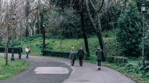 People wearing masks walk in a park in this stock image (Unsplash/Gabriella Clare Marino)