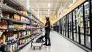 People wearing masks shop at a grocery store in Moncton, N.B., on Wednesday, September, 22, 2021. (THE CANADIAN PRESS/Christopher Katsarov)