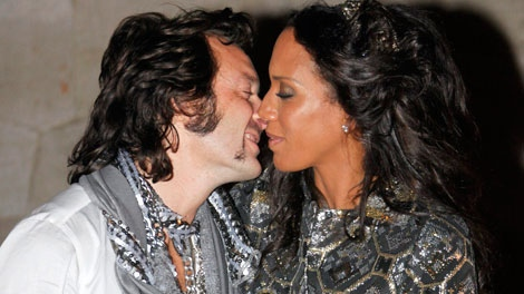 Barbara Becker-Quinze and her husband Arne Quinze kiss each other in front of the Belvedere in Potsdam, Germany on Saturday, Sept. 9, 2009. (AP / Kai-Uwe Knoth)