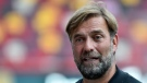 Liverpool's manager Jurgen Klopp speaks to the media prior the English Premier League soccer match between Brentford and Liverpool at the Brentford Community Stadium in London, Saturday, Sept. 25, 2021. (AP Photo/Rui Vieira)