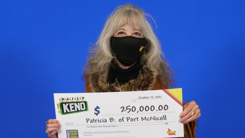 Patricia Bartlett, of Port McNicoll, holds her big cheque for $250,000 after winning with Daily Keno 10 Pick in the Sept. 27, 2021, evening draw. (OLG)