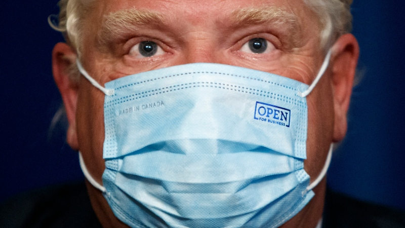 Ontario Premier Doug Ford wears a mask during a press conference at Queen's Park in Toronto, Wednesday, Sept. 22, 2021. THE CANADIAN PRESS/Cole Burston