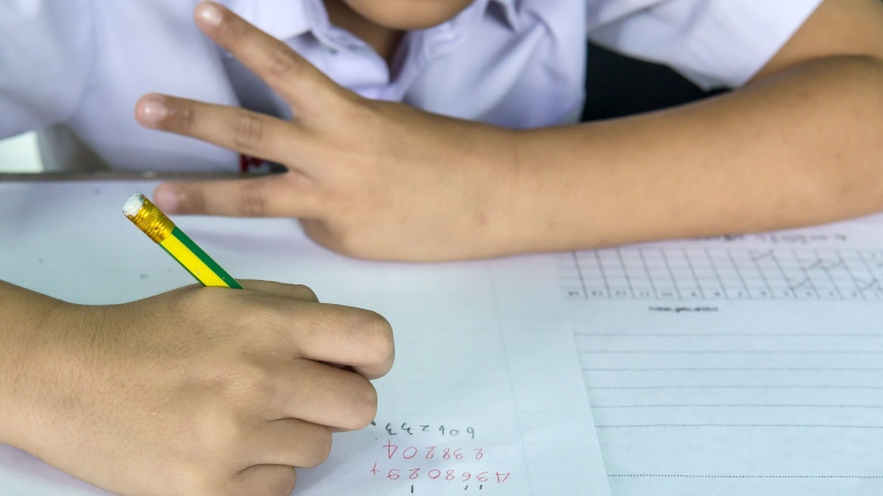 A student works on a test in this stock photo. (Shutterstock)