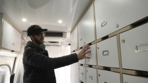 Paved to Pines co-owner Steven Glass explains the features of a van the company transformed into a mobile health clinic for the Prince Albert Grand Council. (Jayda Taylor/CTV News)