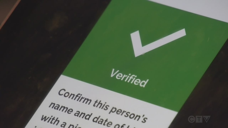 A business in Barrie, Ont., scans a phone for a vaccine verification code and gets a green check mark on Fri., Oct. 15, 2021 (Katelyn Wilson/CTV News)