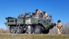 Firefighters work to overhaul the 'minor fire' within a Canadian Armed Forces (CAF) Light Armoured Vehicle on Thursday (Source: Strathcona County Firefighter/Paramedics).