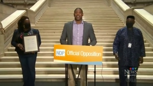 Jamie Moses, NDP MLA for St. Vital, (centre) celebrates the passage of his Emancipation Day Act bill in the Manitoba Legislature on Oct. 15, 2021. (Source: CTV News Winnipeg)