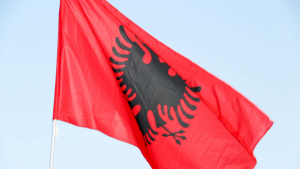 The Albanian national flag is seen in this stock image (Pexels/Petrit Nikolli)
