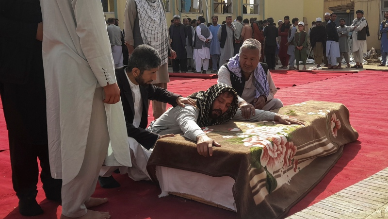 Relatives and residents attend a funeral ceremony for victims of a suicide attack at the Gozar-e-Sayed Abad Mosque in Kunduz, northern Afghanistan, Saturday, Oct. 9, 2021.  (AP Photo/Abdullah Sahil)