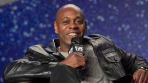 """In this file photo, actor Dave Chappelle attends a press conference to promote the movie """"A Star is Born"""" during the 2018 Toronto International Film Festival in Toronto on Sunday, September 9, 2018. THE CANADIAN PRESS/Fred Thornhill"""