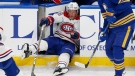 Montreal Canadiens forward Christian Dvorak (28) falls through the bench door during the third period of the team's NHL hockey game against the Buffalo Sabres, Thursday, Oct. 14, 2021, in Buffalo, N.Y. (AP Photo/Jeffrey T. Barnes)