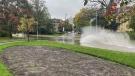 A driver creates a large splash while driving down a flooded street in Ottawa. Oct. 16, 2021. (Josh Pringle / CTV News Ottawa)