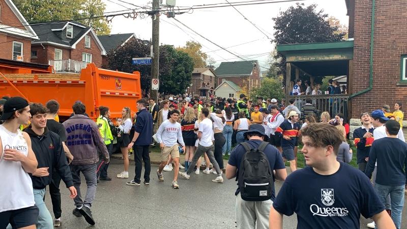 Kingston police and bylaw monitor homecoming celebrations on Aberdeen Street in Kingston, Ont. (Kimberley Johnson/CTV News Ottawa)