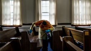 With New Brunswick's fourth wave of COVID-19 putting a focus on places of worship, a professor of theology is disappointed more churches haven't led proactive discussions about vaccines and vaccinations (AP Photo/David Goldman)