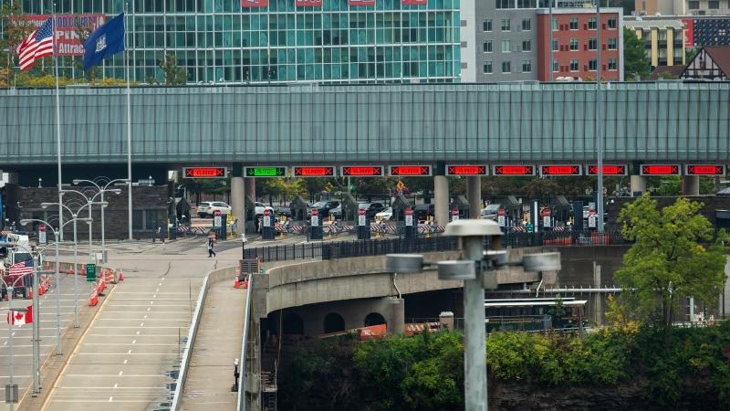 A vehicle crosses the International Rainbow Bridge from Niagara Falls, Ont. into Niagara Falls, N.Y. on Wednesday, October 13, 2021.