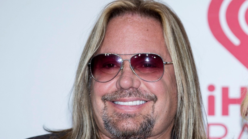 In this Sept. 19, 2014, file photo, Vince Neil arrives at the iHeart Radio Music Festival in Las Vegas. (Photo by Andrew Estey/Invision/AP, File)