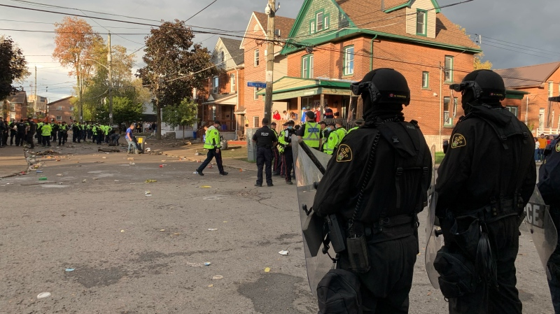 Kingston police and the OPP moved in to break up a large street party during homecoming weekend at Queen's University. (Kimberley Johnson/CTV News Ottawa)