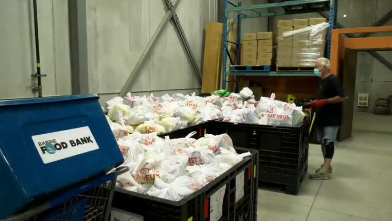 The Barrie Food Bank sorts through a number of donations on Thursday, October 14 (Steve Mansbridge/CTV News)