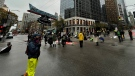 """Four people were arrested at a """"die-in"""" that blocked a downtown Vancouver intersection Saturday afternoon. (CTV)"""