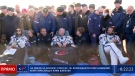 In this photo taken from video footage released by Roscosmos Space Agency, Russian space agency cosmonaut Oleg Novitskiy, centre, actress Yulia Peresild, left, and film director Klim Shipenko sit in chairs shortly after the landing of the Russian Soyuz MS-18 space capsule, southeast of the Kazakh town of Zhezkazgan, Kazakhstan, Sunday, Oct. 17, 2021. (Roscosmos Space Agency via AP)