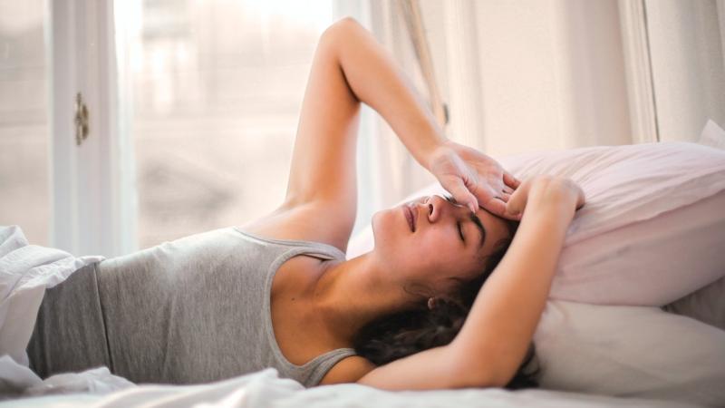 Stock image of a woman having trouble sleeping. (Pexels, Andrea Piacquadio)