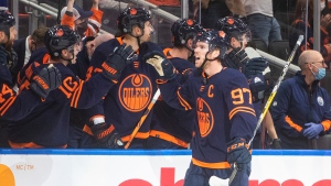 Edmonton Oilers' Connor McDavid (97) celebrates a goal against the Calgary Flames during first period NHL action in Edmonton on Saturday, October 16, 2021 (The Canadian Press/Jason Franson).