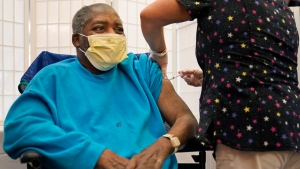 In this Sept. 27, 2021, file photo, Edward Williams, 62, a resident at the Hebrew Home at Riverdale, receives a COVID-19 booster shot in New York. (AP Photo/Seth Wenig)