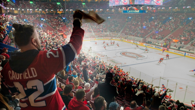 Montreal Canadiens fans cheer during the warm-up skate ahead of the team's opening home season NHL hockey game against the New York Rangers in Montreal, Saturday, October 16, 2021. THE CANADIAN PRESS/Graham Hughes