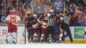 Calgary Flames and Edmonton Oilers players rough it up during first period NHL action in Edmonton on Saturday, October 16, 2021.THE CANADIAN PRESS/Jason Franson