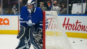 Toronto Maple Leafs goaltender Alexander Bishop (70) warms up before the start of a game against the Ottawa Senators in Toronto on Saturday, October 16, 2021. The Maple Leafs signed the University of Toronto player to a one-day amateur try out as a backup goaltender. THE CANADIAN PRESS/Evan Buhler