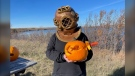 Alanna McIntyre holds up her first underwater carving while wearing her homemade diver helmet. Kaylyn Whibbs/CTV News