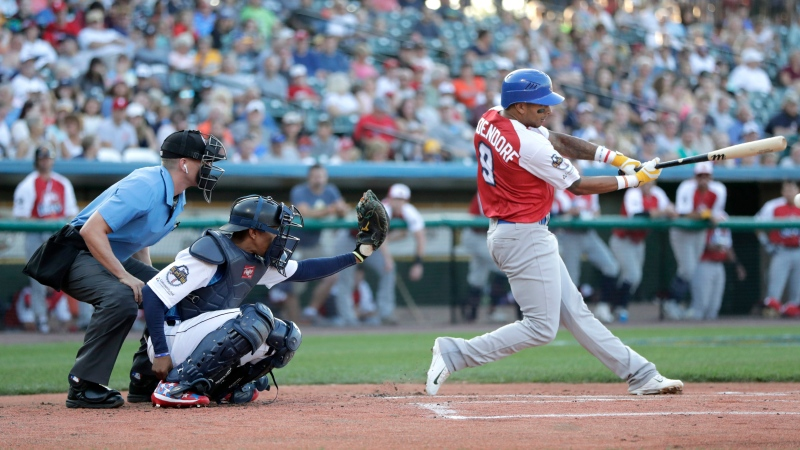 Tyler Ladendorf, right, of the High Point Rockers, swings at a pitch from Mitch Atkins, of the York Revolution, during the first inning of the Atlantic League All-Star minor league baseball game, Wednesday, July 10, 2019, in York, Pa. (AP Photo/Julio Cortez)