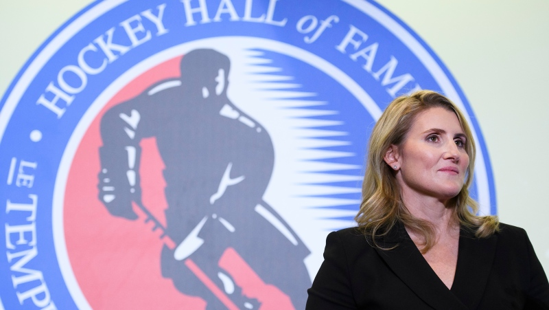 Hockey Hall of Fame inductee Hayley Wickenheiser walks on stage in Toronto on Friday, November 15, 2019. THE CANADIAN PRESS/Nathan Denette