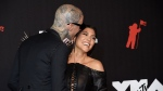 Travis Barker, left, and Kourtney Kardashian arrive at the MTV Video Music Awards at Barclays Center on Sunday, Sept. 12, 2021, in New York. (Photo by Evan Agostini/Invision/AP, File)