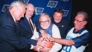 In this Oct. 31, 1996, file photo, former Toronto Huskies players, from left, Dick Schulz, Gino Sovran, Harry Miller and Ray Wertis try to steal the ball from former New York Knicks' Ossie Schectman, the first person to ever score a basket in the NBA, during an event in Toronto to commemorate the original 1946 game teams. (Jeff McIntosh/The Canadian Press via AP, File)