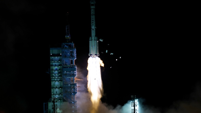 The crewed spaceship Shenzhou-13, atop a Long March-2F carrier rocket, is launched from the Jiuquan Satellite Launch Center in northwest China's Gobi Desert, Oct. 16, 2021 (Chinatopix Via AP)