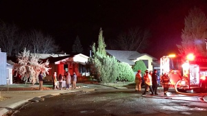A blaze at 60 Street and 37A Avenue NW in the early morning of Oct. 18, 2021, damaged one home's garage and rear side.
